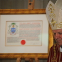 Bishop John Keenan on receiving Letters Patent granting a coat of arms under royal prerogative. photo album thumbnail 44